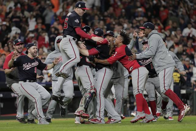 The Washington Nationals celebrate after Game 7 of the baseball World Series against the Houston Astros Wednesday, Oct. 30, 2019, in Houston. The Nationals won 6-2 to win the series. (AP Photo/David J. Phillip)