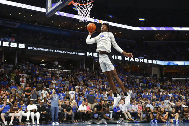 FILE - In this Oct. 3, 2019, file photo, Memphis freshman center James Wiseman dunks the ball during Memphis Madness in Memphis, Tenn. Wiseman headlines the nation's top recruiting class at Memphis, but he isn't the only first-year player that figures to make an impact this season.  (Joe Rondone/The Commercial Appeal via AP, File)