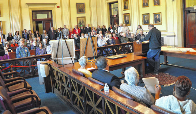 Citizens packed the Clinton County Common Pleas courtroom as local officials, including County Engineer Jeff Linkous, spoke about the courthouse's history on Saturday.