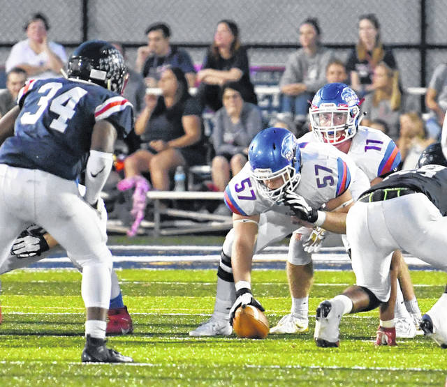 Clinton-Massie center Bryan Kennedy (57) ready to snap the ball to quarterback Tate Olberding during last week's game at Columbus Bishop Hartley.