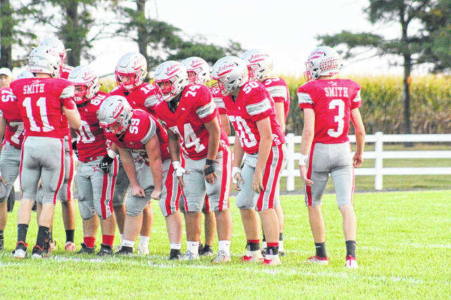 East Clinton's offensive huddle during last week's game against Minford.