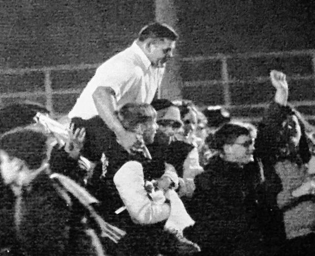 Head coach Jim Knowles was carried off the field following Wilmington's 30-14 win over Circleville in 1969, a win that clinched the Gold Football for the Hurricane. The photo is from the Wilmington High School yearbook.