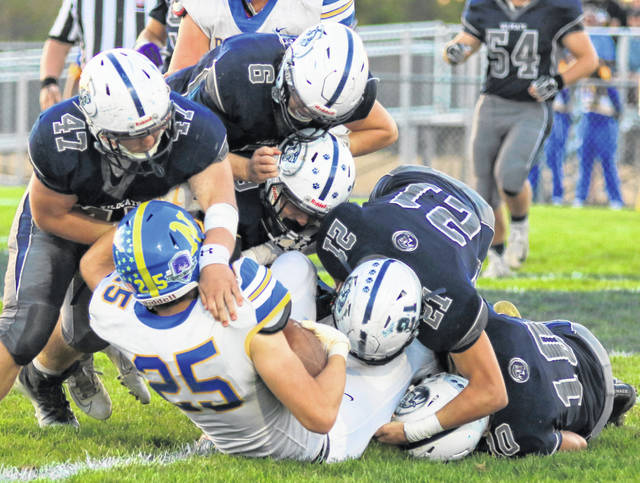 Blanchester gang tackle with James Peters (47), Colt Conover (6), Gage Huston (21) and Kadin Berwanger (10) bring down a CNE ball carrier during last week's game.