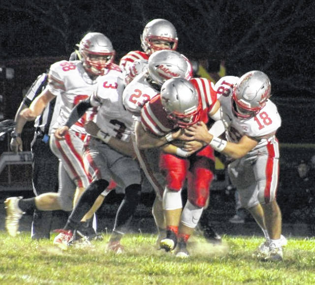 East Clinton's Patrick Dotson (88), Branson Smith (3), Isaiah Conger (23) and Kaleb Kingery (18) with a gang tackle on a Bethel-Tate ball carrier.