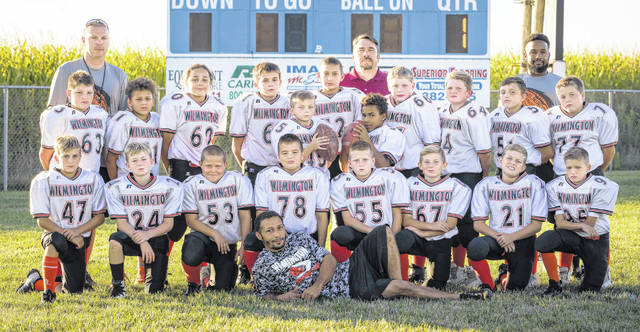 The Wilmington Hurricane Youth Football Program fifth grade will play 5 p.m. Sunday at Kettering's Roush Stadium for the Western Ohio Junior Football Conference Gold bracket championship. Wilmington, the No. 1 seed in the tournament, will play No. 2 seed Wayne for the overall WOJFC crown. In the photo, Wilmington team members and coaches are, from left to right, front row, coach Tino; second row, Max McCoy, Cooper Short, Connor Hornschemeier, Matthew Manson, Isaac Newberry, Chase Hurtt, Ayden Murphy, Chris Lindsey; third row, AJ Kirk, Josiah Puller; fourth row, Ethan Bailey, Phayden Mawyer, Trenton Shinkle, Damian Simpson, Carson Jones, Nickolas Clark, Ioan Cioca, Jared Tackett, Colton Knisely; back row, coach James Kirk, coach Joe Clark, coach Mike Brown. Not present for the photo were coach Matt Short and team mom Wendy Short.