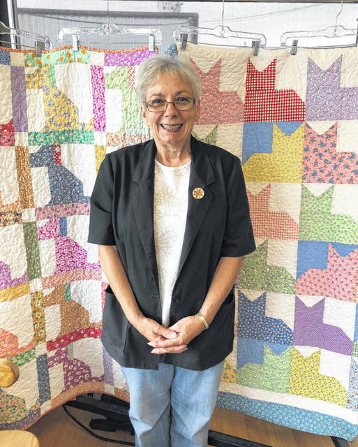 The Clinton County Humane Society recently held a quilt raffle as fundraiser for the shelter at 1760 Fife Ave. Two quilts, handmade and donated by Georgann Quallen (pictured), were offered in the raffle: one featuring puppies and one featuring kittens. The Cotton Junky and Weathervane Dry Cleaners hosted the drawings. Quallen, pictured in the photograph, drew the names of the winners on Oct. 7. The winning entries were Shannon Boone for the kitten quilt and Mary Thomas Watts for the puppy quilt.
