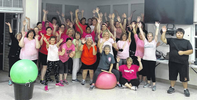 "Cardio Drumming class participants honored breast cancer survivors during the ""Wear Pink Class"" in support of Cancer Awareness Month. Cardio Drumming is a fun fitness class suitable for all fitness levels. It's affordable, provides community support and is a judgement free atmosphere. Classes are held at the Wilmington Savings Bank Clinton County Senior Center on Tuesdays from 7:30-8:30 p.m. Check it out on Facebook at Cardio Drumming Southwest Ohio or email cardiodrumswohio@gmail.com for more information."