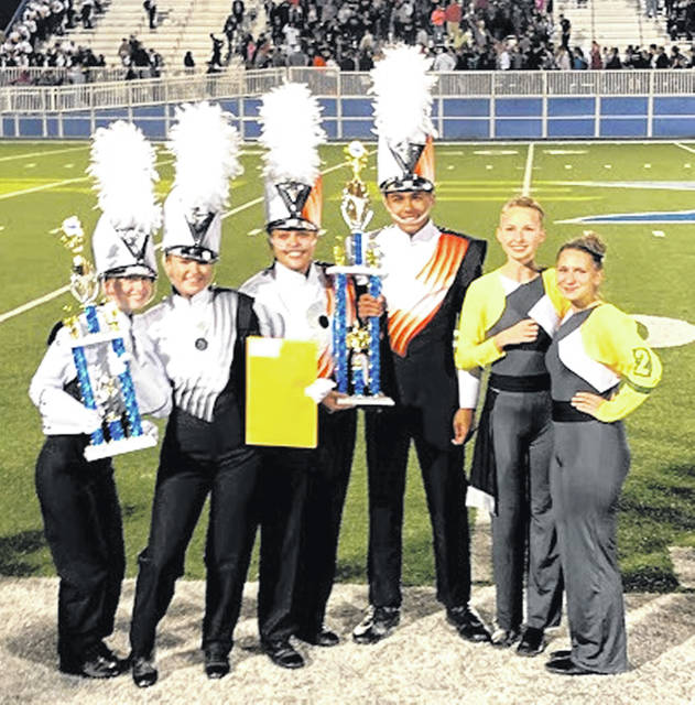 From left are drum majors Elizabeth Grimes and Kylie Bayless; percussion leadership Bella Gammell and Ben Baylor; and guard leadership Devan Tackett and Ashlee Griffith.