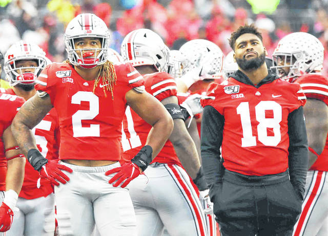 Chase Young (2) and teammates watch the video scoreboard during Saturday's win over Wisconsin.
