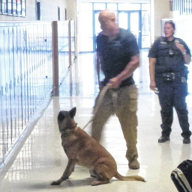 "The Blanchester Police Department took drug detecting dogs into Blanchester High School Wednesday to check for illegal narcotics. The dogs also sniffed cars in the high school parking lot. ""It is a credit to our school administrators that, as in year's past, no illegal narcotics were detected,"" said Police Chief Scott Reinbolt. The drug sniffing dogs were brought to the school under a contract between K-9 Solutions and the police department. K-9 Solutions is a private company in New Carlisle, Ohio that provides police K-9 training as well as drug detection services to private industry."