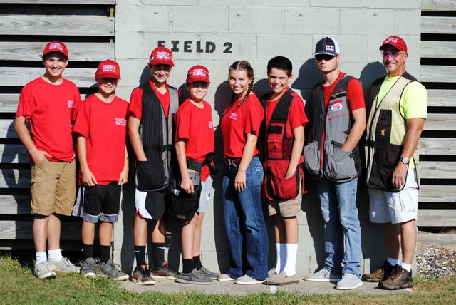 In the photo, from left to right, Colten Woods, Nate Ellis, Aaron Rolfe, Kale Boeckmann, Carlie Ellis, Mitchell Ellis, Cade Stewart, coach Bruce Warren. Team members Brody Fisher, Hayden Pirman, Carter Carey, Preston Dixon, coach Cindy Warren, and assistant coaches Steve Sharp and Tim Woods were not present for the photo.