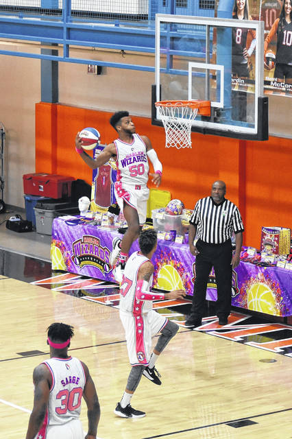 A local team representing Wilmington schools got a chance to go up against the talent as well as shenanigans of the World Famous Harlem Wizards at a special game fundraiser on Thursday night at Wilmington Middle School.