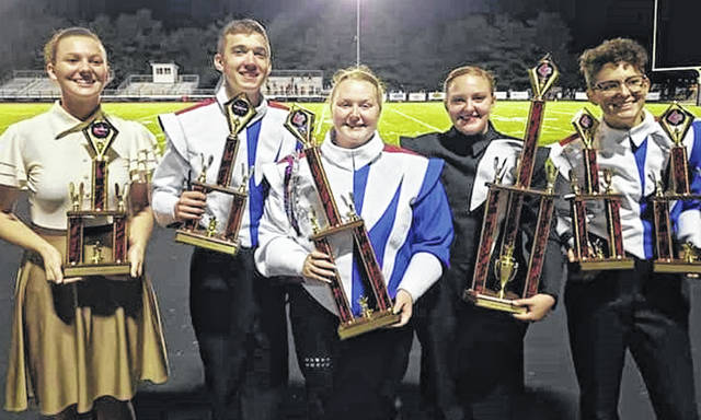 From left are band award winners Kaylynn Woolverton, DJ Young, Erika Keller (assistant field commander), Olivia Swicegood (field commander) and Maggie Williams.