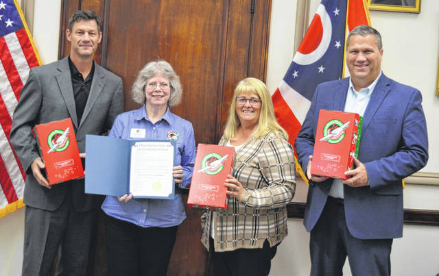 The month of November was proclaimed Operation Christmas Child Month, and the Clinton County commissioners are encouraging community members to take part in the drop-off week from noon to 6 p.m. Monday, Nov. 18 to Monday, Nov. 25 (except Saturday, Nov. 23 when hours are noon to 4 p.m.). That week in Clinton County, the drop-off sites for gift-filled shoeboxes are Calvary Baptist Church, 1920 U.S. 22/S.R. 3 west near Wilmington, and Blanchester Church of Christ, 911 Cherry St. in Blanchester. The gifts reach children in need around the world, and things such as school supplies, hygiene items and fun toys are among the main requests by Operation Christmas Child. From left are Clinton County Commissioner Kerry Steed, Operation Christmas Child area coordinator Barbara Lanctot, and Clinton County Commissioners Brenda Woods and Mike McCarty.