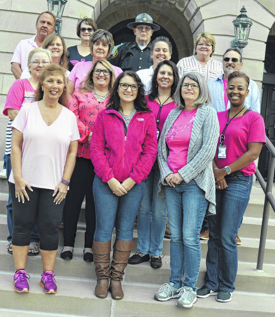 For Breast Cancer Awareness Month, many Clinton County Courthouse employees wear pink on Fridays in October. And though it doesn't show in the photo, Clinton County Deputy Sheriff Sam Smith in the top row is wearing a pink badge.