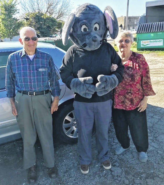 "Buster the Mouse from the Clinton County Solid Waste District has caught the second weekly winners in the Get Caught Recycling Campaign. John and Betty Baker were caught ""green-handed"" putting the proper recyclables into the community drop-off recycling containers located across from the post office in Blanchester. For their efforts in practicing the 3-R's, Mr. and Mrs. Baker received several recycled-content prizes, including a hammock, a reusable shopping tote bag, and more. Don't miss out on this chance to win great prizes by simply recycling household items such as bottles, jars and newspapers. For a list of the local recycling drop-off locations and acceptable materials, visit the SWMD's website at www.co.clinton.oh.us/recycling. And be on the lookout … you could be the next person caught green-handed!"