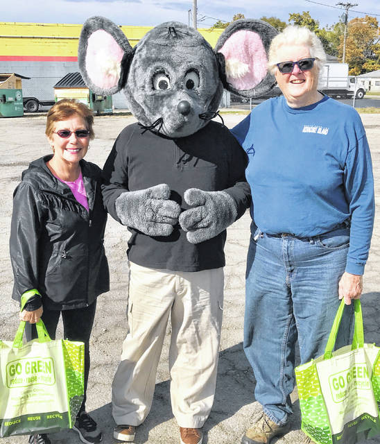 Buster the Mouse from the Clinton County Solid Waste District recently caught Peggy Duncan (left) and Lynn Bare putting proper recyclables into the community drop-off recycling containers on West Main Street in Wilmington. For their efforts in practicing the 3-Rs, Peggy and Lynn each received recycled-content prize packs. Don't miss out on this chance to win great prizes by simply recycling household items such as bottles, jars, and newspapers. For a list of the local recycling drop-off locations and acceptable materials, visit the SWMD's website at www.co.clinton.oh.us/recycling. Be on the lookout — you could be the next person caught green-handed!
