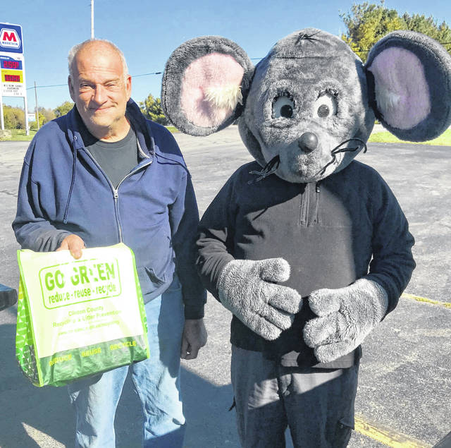Buster the Mouse from the Clinton County Solid Waste District caught the final winner in the 2019 Get Caught Recycling Campaign. Frank Cunningham was caught putting the proper recyclables into the residential recycling drop-off containers located at Streber's Market in New Vienna. For his efforts in practicing the 3Rs, Mr. Cunningham received several recycled-content prizes, such as a hammock, tote bag, boomerang, and other fun items. Although the 2019 Get Caught Recycling Campaign has come to an end, the Solid Waste District encourages all residents to practice good recycling year-round. For a list of the local recycling drop-off locations and acceptable materials, visit the SWMD's website at www.co.clinton.oh.us/recycling. Be on the lookout – you never know where Buster the Mouse might be lurking next!
