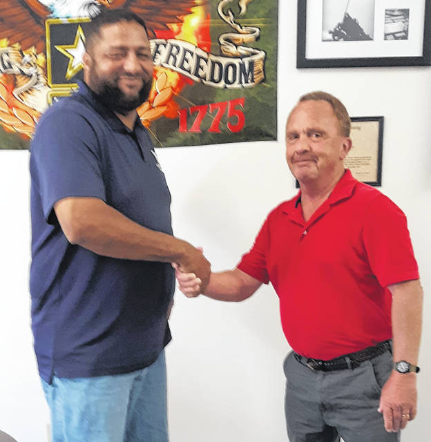 Jeff Rollins, left, in his office with Ray Souder, Executive Director of the Clinton County Veterans Service Commission.
