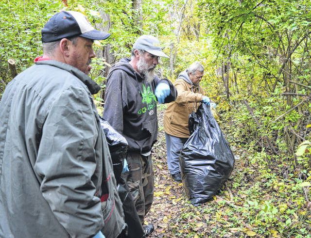 People from Sugartree Ministries in Wilmington clean up the Dr. Nathan Hale Nature Trail. The trailhead is near the Denver Williams Park playground north of the duck pond; the trailhead can be accessed from the paved Judy Gano Trail.