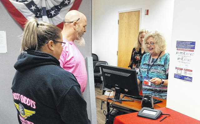 In-person early voting for the Nov. 5 general election began this week at the Clinton County Board of Elections on South Nelson Avenue in Wilmington. Shown are Jason Stoops and Leah Lorenz of Wilmington checking in to cast their votes.