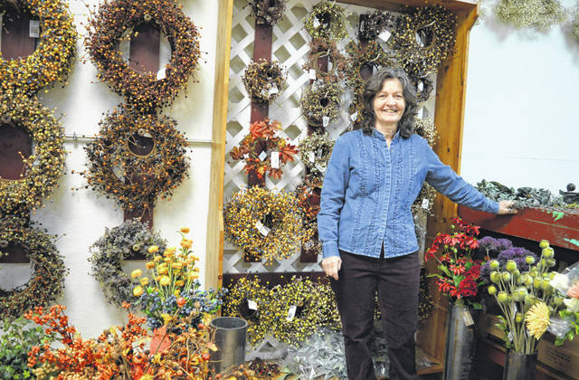 New co-owner Diane Dell has a floral design booth at the Sugartree Mill Co. in Wilmington.