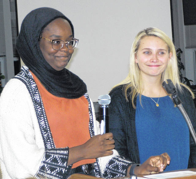From left are Ohio State students Fereedah Haroun and Patricia Fass, who spoke to the Wilmington Lions.