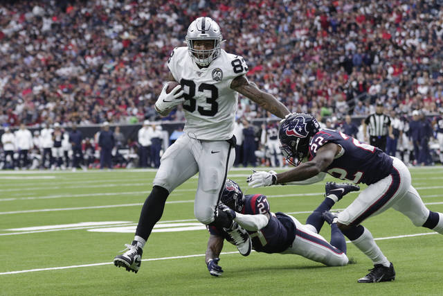 Oakland Raiders tight end Darren Waller (83) scores a touchdown past Houston Texans cornerback Gareon Conley (22) after a catch during the first half of an NFL football game Sunday, Oct. 27, 2019, in Houston. (AP Photo/Michael Wyke)