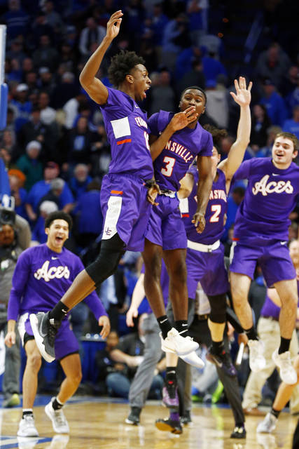 Evansville's DeAndre Williams, top left, and Jawaun Newton (3) celebrate after the team's NCAA college basketball game against Kentucky in Lexington, Ky., Tuesday, Nov. 12, 2019. Evansville won 67-64. (AP Photo/James Crisp)
