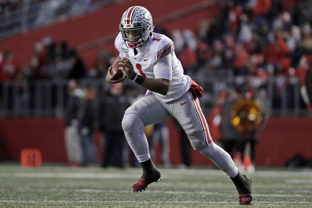 Ohio State quarterback Justin Fields (1) rushes against Rutgers during the first half of an NCAA college football game Saturday, Nov. 16, 2019, in Piscataway, N.J. (AP Photo/Adam Hunger)