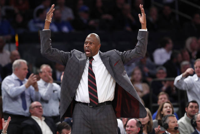 Georgetown head coach Patrick Ewing encourages the crowd to get behind his team during the second half of the first round of the 2K Empire Classic NCAA college basketball tournament against Texas, Thursday, Nov. 21, 2019, in New York. Georgetown defeated Texas 82-66. (AP Photo/Kathy Willens)
