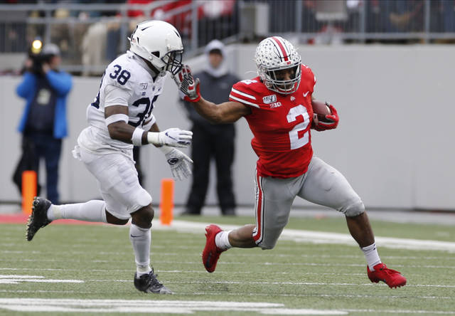 Ohio State running back J.K. Dobbins, right, cuts up field against Penn State defensive back Lamont Wade during the first half of an NCAA college football game Saturday, Nov. 23, 2019, in Columbus, Ohio. (AP Photo/Jay LaPrete)
