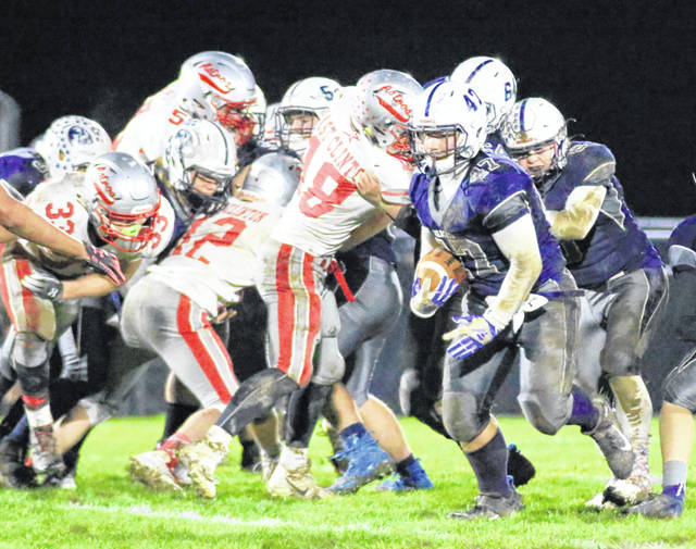 Blanchester's James Peters (47) carries the ball against East Clinton's defense Friday night at Barbour Memorial Field.