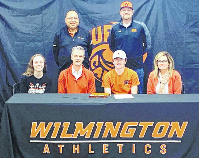 Wilmington High School senior Jack Murphy has signed to play golf at Lourdes University, joining former WHS teammate Hunter DeWeese on the Gray Wolves squad. Lourdes University is an NAIA institution located in Sylvania, Ohio. In the photo, from left to right, seated, sister Katie Murphy, father Kyle Murphy, Jack Murphy, mother Shari Murphy; back row, Lourdes head coach Gill Guerrero and Wilmington head coach Phil Gilmore.