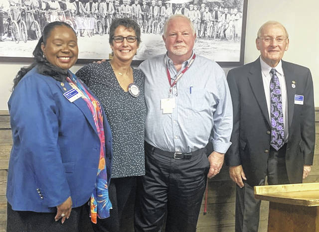 From left are Sigrid Solomon, District Governor of Rotary; Katherine Harrison Tigar, President of the Wilmington Rotary Club; Brad Reynolds, President of the AM Rotary Club; and James Perry, Assistant Governor of Rotary.