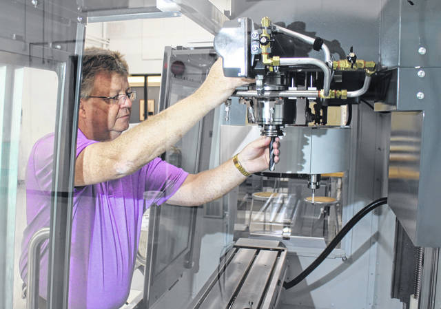 Jim Barnett, Assistant Professor of Engineering, works with CNC equipment at Southern State Community College in Hillsboro.