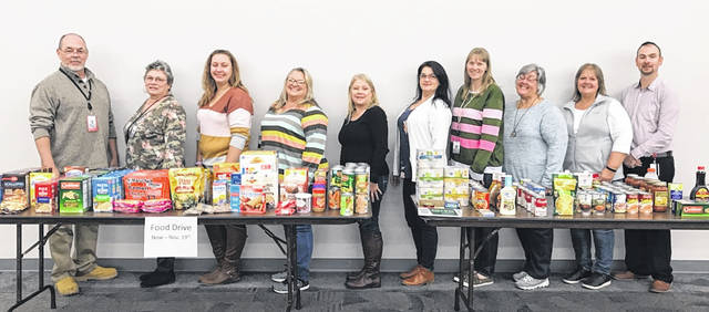 Fifth Third Bank employees recently collected food items and donated them to the Clinton County Community Action food pantry to assist county residents with food. Some of the employees who participated are pictured.
