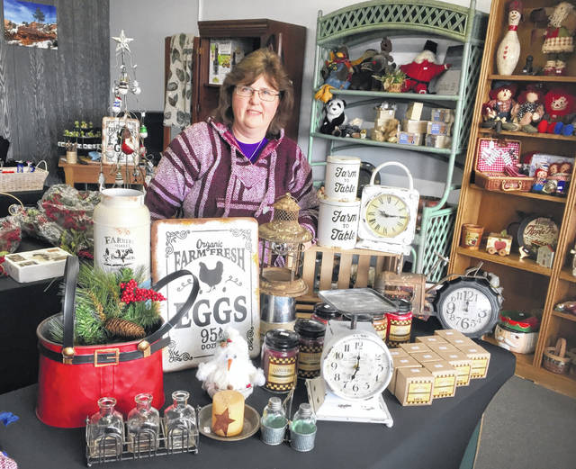 Lisa Beach with part of the array of gifts at the new shop.