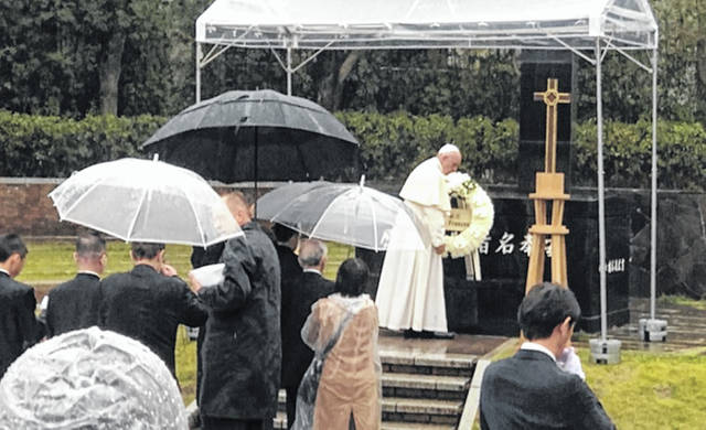 Pope Francis spoke Sunday in Nagasaki, Japan, about eliminating nuclear weapons against a backdrop that featured an atomic-bombed cross that was at Wilmington College for 37 years. Courtesy of Professor Hirokazu Miyazaki of Northwestern University, who was instrumental in arranging WC's return of the cross to Urakami Cathedral in August.