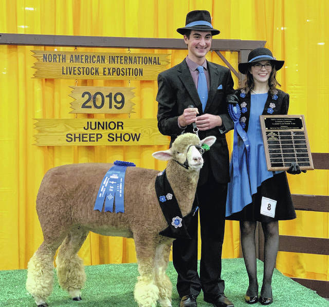 Alyssa Hutchinson and Jacob Lansing, Jefferson Jets 4H members, recently took first place in the Sheep Leading competition during the North American International Livestock Exposition in Louisville, Ky. The two competed in the Pairs Division with individuals across the U.S. Lead judging is based on presentation and appearance of wool garments as well as control of the sheep. Alyssa and Jacob's outfits were well coordinated and made mostly of 100-percent wool. Alyssa's grandmother, Vickie Wagner, made Alyssa's dress and Jacob's coordinating accessories. Both Alyssa and Jacob have showed sheep at the Clinton County Fair and the Ohio State Fair. This year they also won the Sheep Lead Pairs Division at both the Highland County Fair and the Ohio State Fair. Congratulations to Alyssa and Jacob.