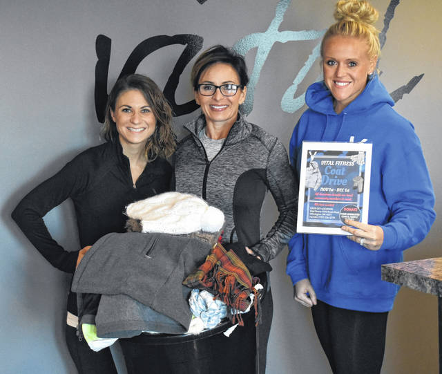 From left, Katie Croucher, Amy Zimmerman, and Lara Wilkinson of Vital Fitness were already seeing success at the beginning of their coat drive at the beginning of November. Accepting donations for annual coat drive, including hats and gloves