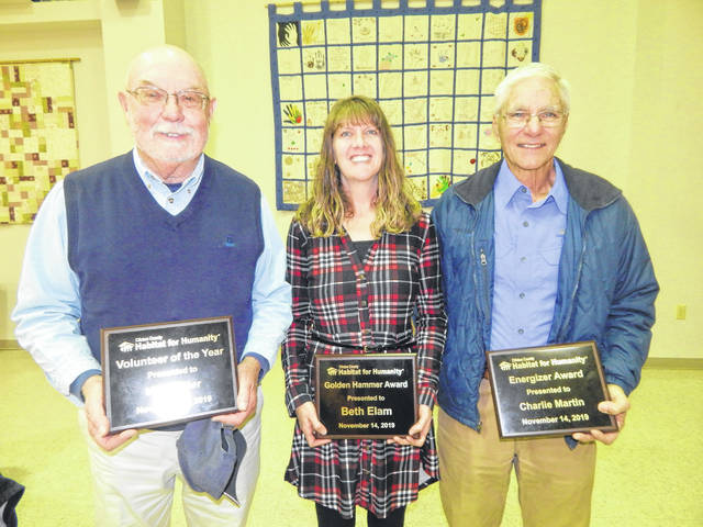 From left are Clinton County habitat for Humanity honorees Mike Miller, Beth Elam and Charlie Martin.