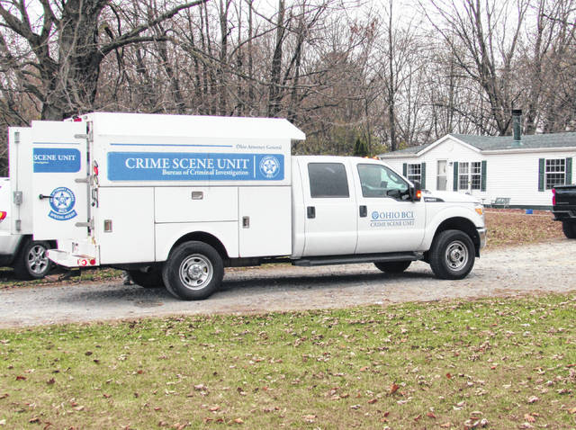 Vehicles from the Bureau of Criminal Identification and Investigation are pictured at the scene of a fatal shooting Monday in Willetsville.