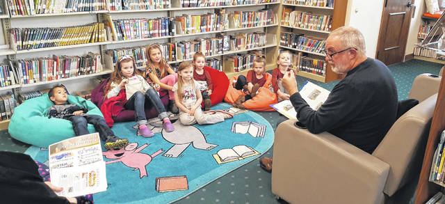 British expatriate Robert Eggleton reads his childhood favorite stories of Thomas the Tank Engine to children at the Wilmington Public Library Tuesday evening. Another reading will be held at 5 p.m. next Tuesday.