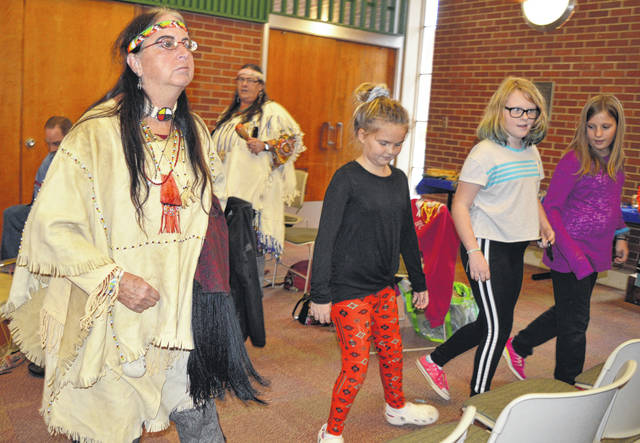 East End Elementary School fifth-grade students, in right foreground, had a chance Thursday to emulate the dance steps of a Native American.