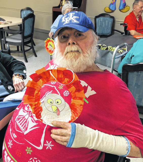 At Continental Manor, Don was among those working with Blanchester FFA to make turkey wreaths.