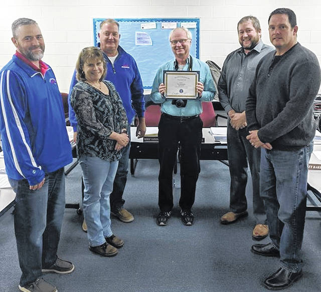 The Clinton-Massie Local Schools Board of Education recognizes the News Journal's Gary Huffenberger.