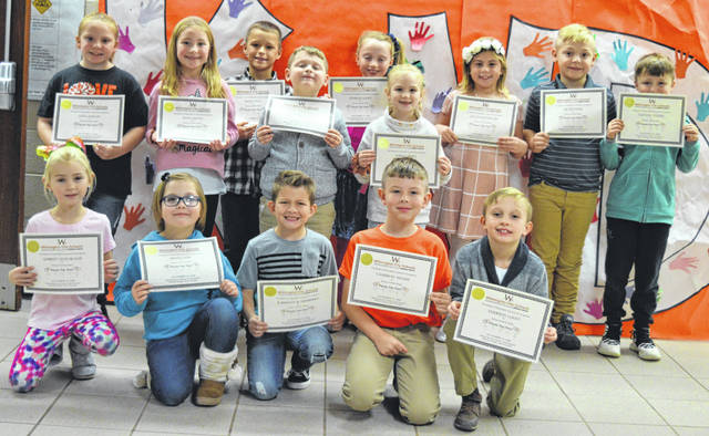 These second-grade Holmes Helpers from Holmes Elementary School are being groomed to be leaders and good models around the school building and community, said Marilee Tanner, principal at Holmes Elementary where second-graders are the oldest pupils in the K-to-2 building. From left in the front row are Aubrey Huelskamp, Emma Cox, Karrson Scarrberry, Cameron Adams and Emerson Looft; and from the left in the back row are Lola Dallas, Riley Smith, Miles Wolf, Avery DeBoard, Everlee Looft, Kirra Priest, Lila Wagenseller, Lee Rethmel and Colton Young. Members of the Holmes Helpers not pictured are Jensen Mueller, Laneya Nace, Luther Johnson, Tad Shidaker, Nova Fall, Ali Varvel, Mya Milliner, Braxton Reed, Joey Bennett, Jasmine Woods and Trinity Steers.