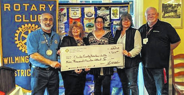 From left are: Fadi Al-Ghawi, AM Rotary Cardboard City 2019 co-chair; Denise Stryker, director of the shelter; Amber Taylor, assistant director of the shelter; Becky Boris, shelter board member; and Brad Reynolds, AM Rotary Club President.