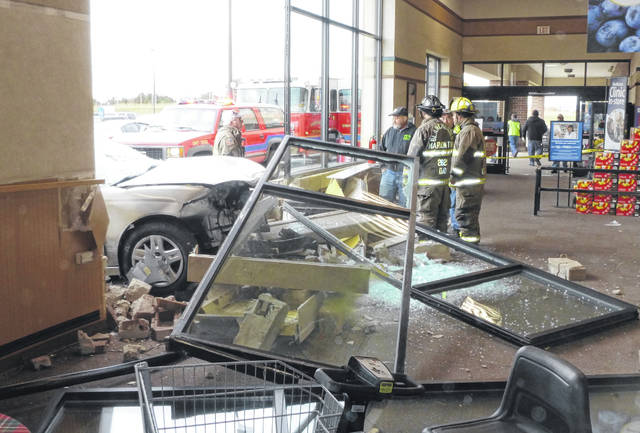 The views both inside and outside of the Kroger store after a car crashed into the store Saturday.